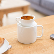 A white ceramic coffee cup that can be used on both sides